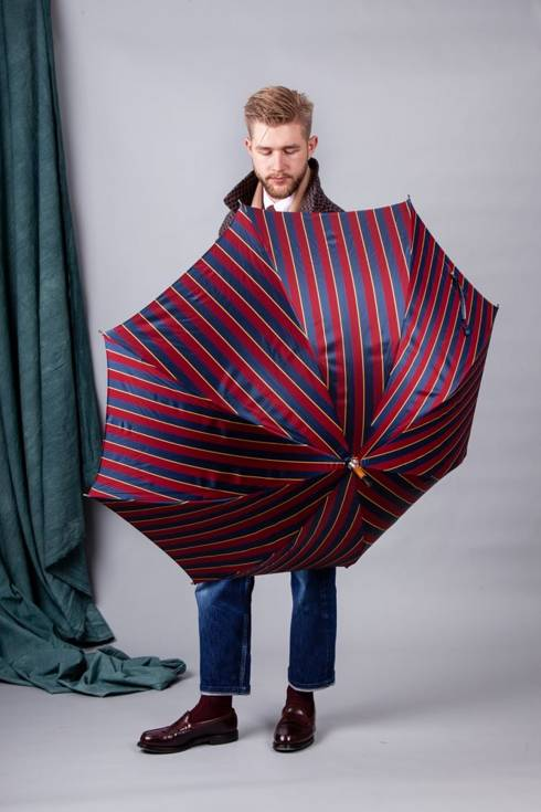 Striped long wooden umbrella
