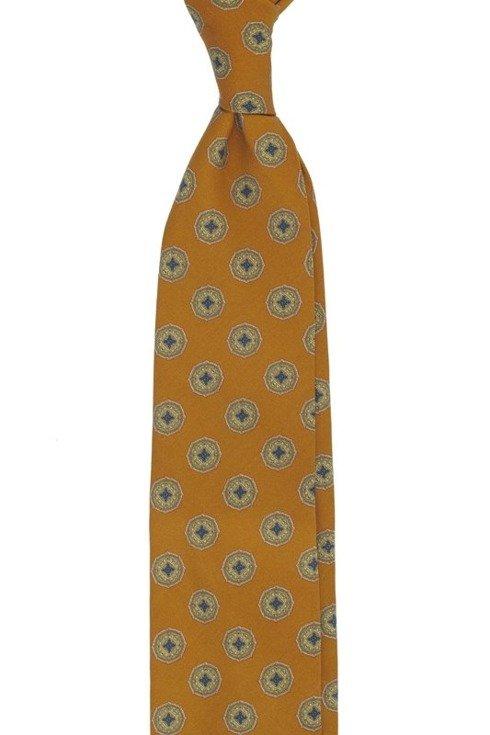 Pomarańczowy krawat w medaliony bez podszewki z wełny drukowanej